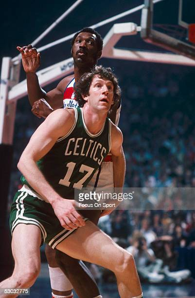Boston Celtics' John Havlick blocks against the Washington Bullets' Elvin Hayes at Capital Center circa the 1970's in Washington DC NOTE TO USER User...