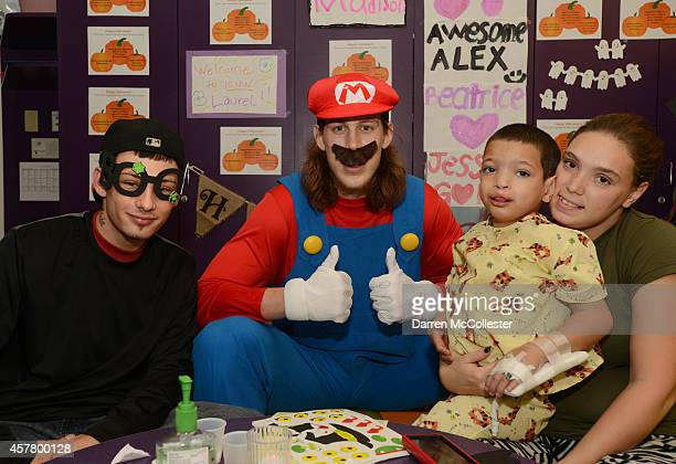 Boston Celtics Kelly Olynyk spends time Joseph Mom and Dad at Boston Children's Hospital October 24 2014 in Boston Massachusetts
