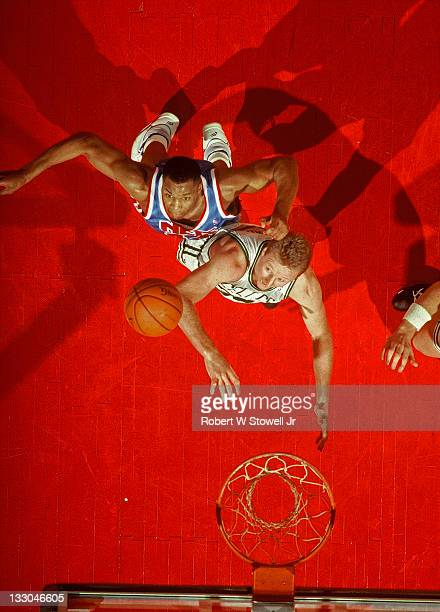 Boston Celtics Larry Bird and New Jersey Nets Derrick Coleman fight for a rebound during a game in Hartford Connecticut 1992