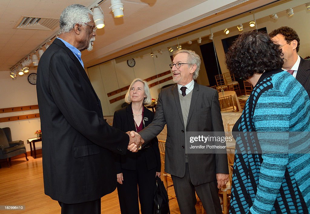 Boston Celtics legend Bill Russell shakes hands with Steven Spielberg at the 2013 W.E.B. Du Bois Medal at a ceremony at Harvard University's Sanders Theatre on October 2, 2013 in Cambridge, Massachusetts.