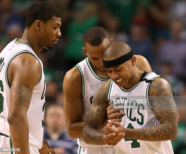 Boston Celtics Marcus Smart and Avery Bradley checks on teammate Isaiah Thomas after a hard foul against the Chicago Bulls during fourth quarter...