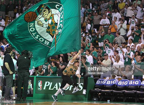 Boston Celtics mascot Lucky the Leprechaun gets the crowd going during the pre game festivities Boston Celtics NBA basketball action and reaction The...