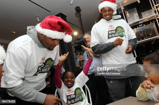 Boston Celtics Paul Pierce and Glen Davis play Christmas Bingo with Niyah Winspeare and fellow classmates from the Marshall Elementary School...