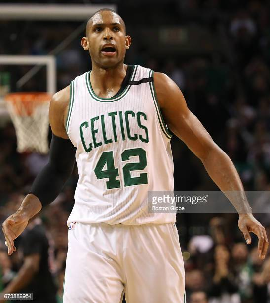 Boston Celtics player Al Horford reacts after making a 3point basket against the Chicago Bulls during third quarter action of game 5 of the NBA...