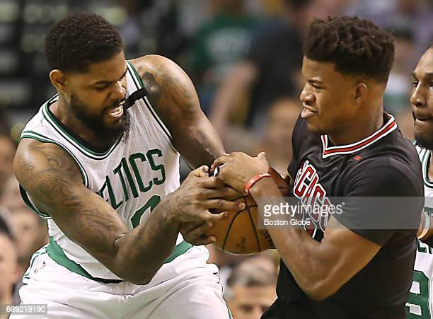 Boston Celtics player Amir Johnson forcing a jump ball with Chicago Bulls player Jimmy Butler during first quarter action of the first round of the...