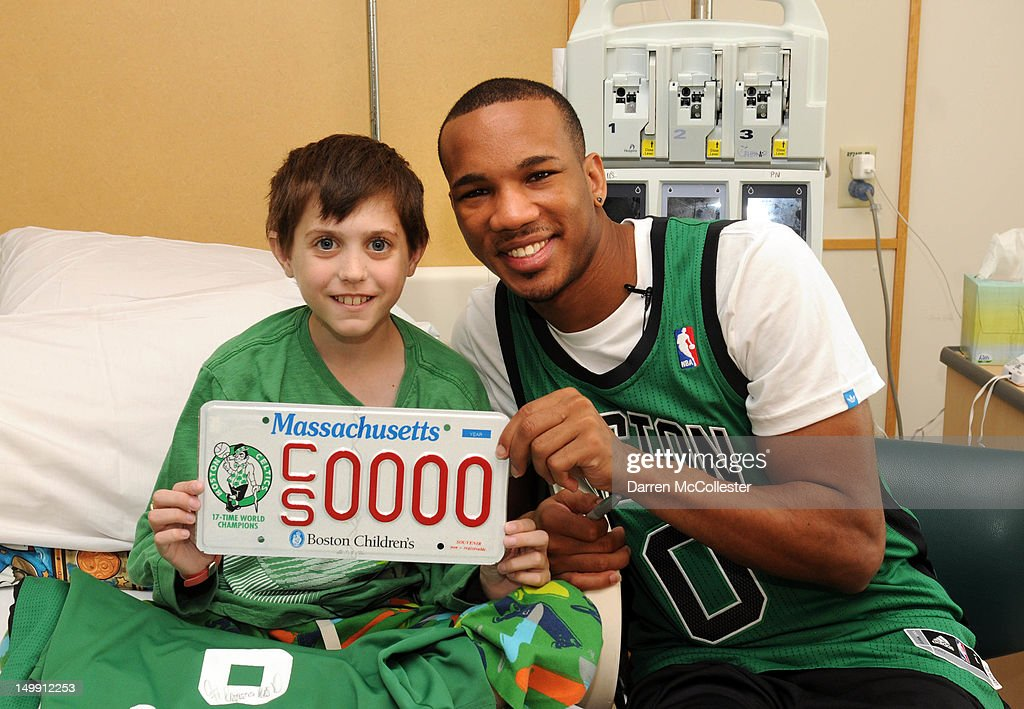 Boston Celtics Player <a gi-track='captionPersonalityLinkClicked' href=/galleries/search?phrase=Avery+Bradley&family=editorial&specificpeople=5792051 ng-click='$event.stopPropagation()'>Avery Bradley</a> Joins Boston Children's Hospital RE/MAX Appreciation Day with Zeke at Boston Children's Hospital on August 6, 2012 in Boston, Massachusetts.