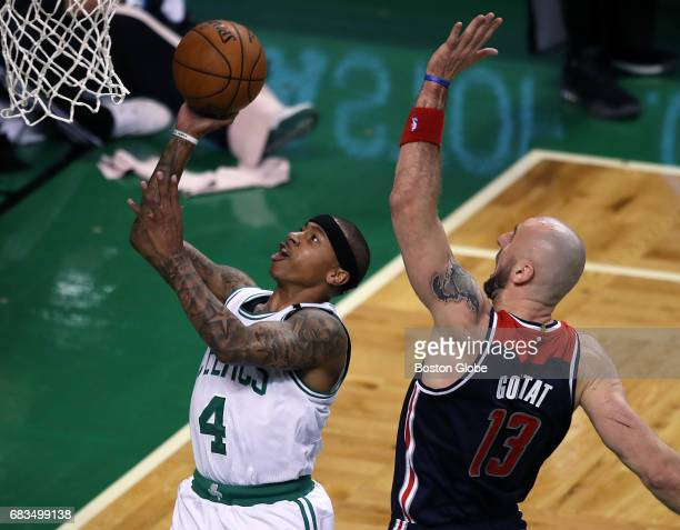Boston Celtics player Isaiah Thomas glides by Washington Wizards player Marcin Gortat as he scores two second quarter points The Boston Celtics...