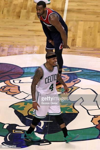 Boston Celtics player Isaiah Thomas is all smiles as the final seconds tick off the clock Washington Wizards player John Wall is not as happy The...