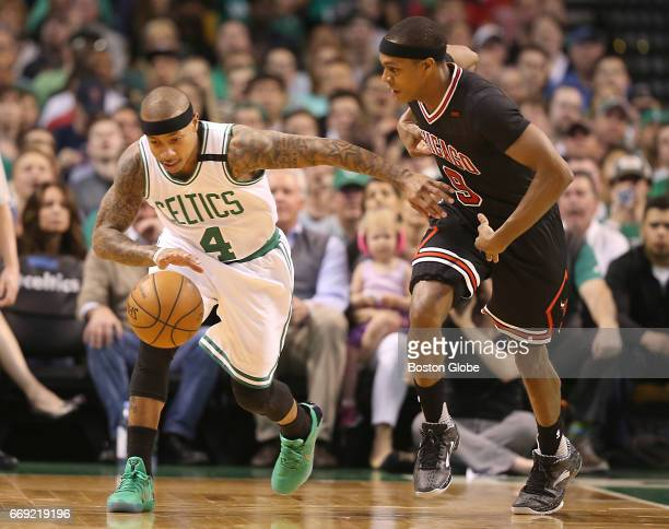 Boston Celtics player Isaiah Thomas leads the break with pressure from Chicago Bulls player Rajon Rondo during first quarter action of the first...