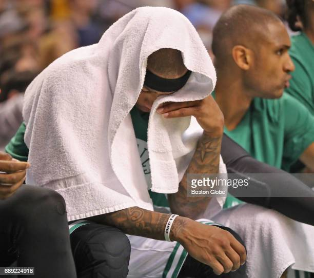 Boston Celtics player Isaiah Thomas sits on the bench against the Chicago Bulls during third quarter action of the first round of the NBA Playoffs at...