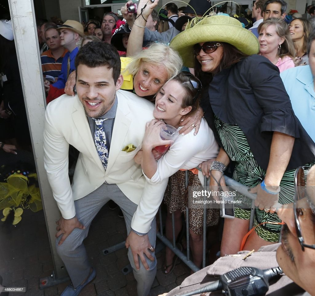 Boston Celtics player Kris Humphries had his photo taken with (left to right) Tammy Pickett, Cherish Denton and Trescia Heacock before the 140th running of the Kentucky Derby at Churchill Downs in Louisville, Ky., Saturday, Saturday, May 3, 2014.