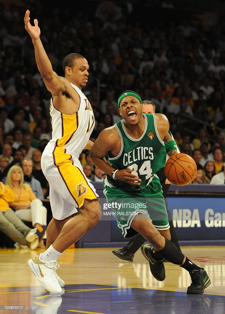 Boston Celtics player Paul Pierce is guarded by LA Lakers guard Shannon Brown before the Celtics won 10394 in game two of the NBA finals at the...