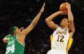 Boston Celtics player Paul Pierce tries to block LA Lakers guard Shannon Brown before Boston Celtics went on to win 10394 in game two of the NBA...