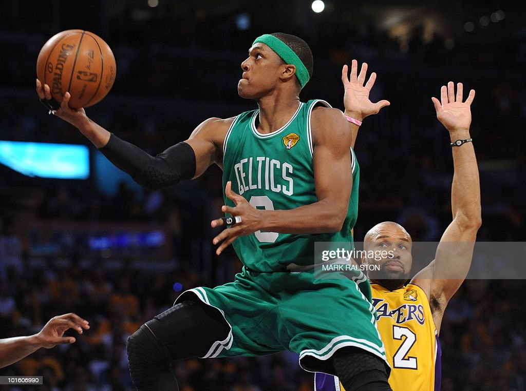 Boston Celtics player Rajon Rondo shoots for goal as LA Lakers guard Derek Fisher (R) looks on before the LA Lakers went on to win 102-89 in game one of the NBA finals at the Staples Center in Los Angeles on June 3, 2010. The defending champion Los Angeles Lakers are not only seeking their 16th NBA championship but also redemption after a humbling loss to the Boston Celtics in the 2008 NBA finals. The Lakers still have the bitter after taste of their humiliating finals loss two years ago. AFP PHOTO/Mark RALSTON