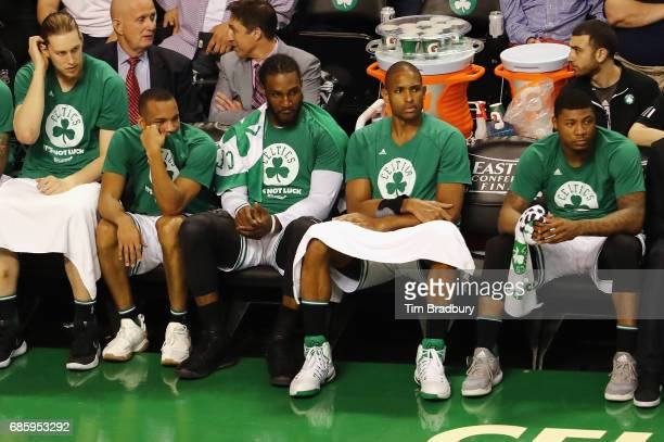 Boston Celtics players including Kelly Olynyk Avery Bradley Jae Crowder Al Horford and Marcus Smart react on the bench during the fourth quarter...
