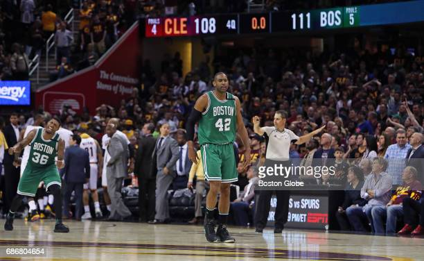 Boston Celtics players Marcus Smart and Al Horford celebrate as time expires in Boston's 111108 victory over the Cleveland Cavaliers The Boston...