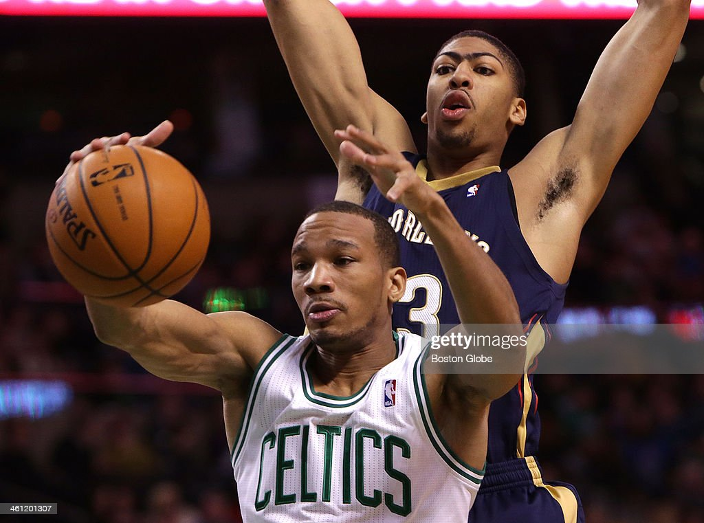 Boston Celtics point guard Avery Bradley battles for a rebound in front of New Orleans Pelicans power forward Anthony Davis in the second quarter The...