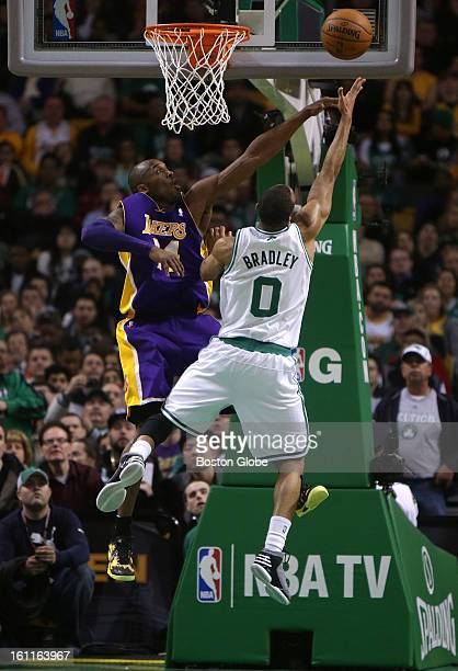 Boston Celtics point guard Avery Bradley is defended by Los Angeles Lakers shooting guard Kobe Bryant as he drives to the basket off a fast break in...