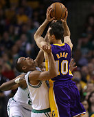 Boston Celtics point guard Avery Bradley play tight defense on Los Angeles Lakers point guard Steve Nash during the first quarter as the Boston...