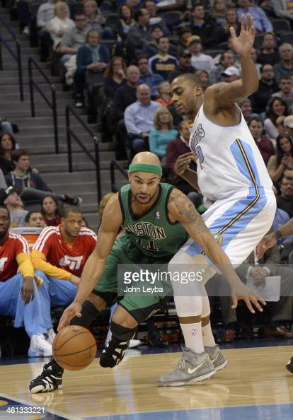 Boston Celtics point guard Jerryd Bayless drives around Denver Nuggets power forward Darrell Arthur during the third quarter January 7 2014 at Pepsi...