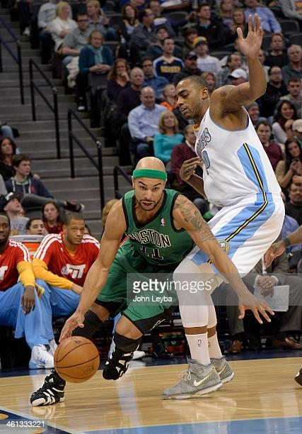 Boston Celtics point guard Jerryd Bayless drives around Denver Nuggets power forward Darrell Arthur during the third quarter January 7 2014 at Pepsi...