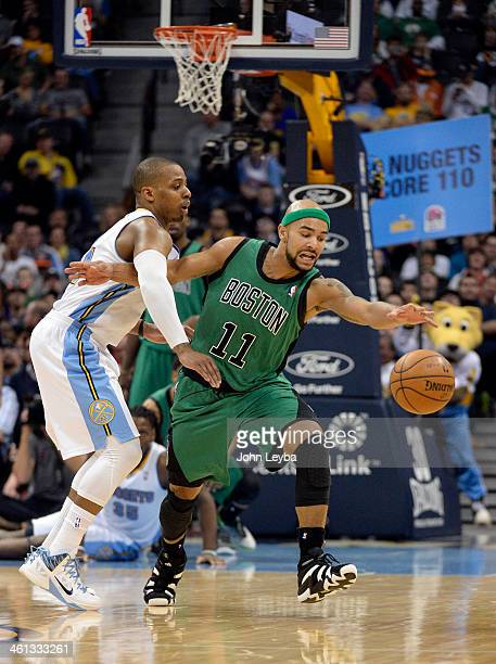 Boston Celtics point guard Jerryd Bayless reaches out for the ball after getting fouled by Denver Nuggets shooting guard Randy Foye during the fourth...