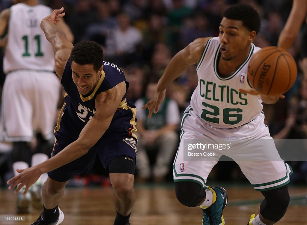 Boston Celtics point guard Phil Pressey steals the ball from New Orleans Pelicans point guard Brian Roberts in the fourth quarter The Boston Celtics...