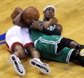 Boston Celtics point guard Rajon Rondo and Miami Heat small forward Shane Battier battle for a loose ball in the first quarter Boston Celtics NBA...