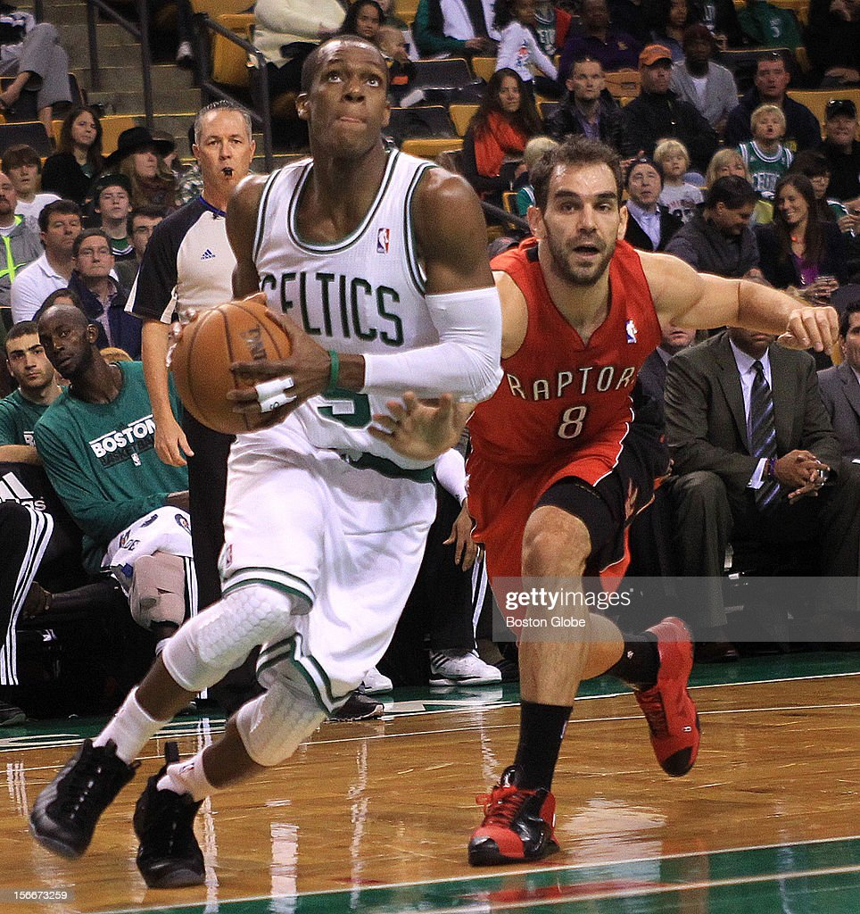 Boston Celtics point guard Rajon Rondo (#9) showed no effects of a sprained ankle as he blew past Toronto Raptors point guard Jose Calderon (#8) in the first quarter as the Celtics play the Toronto Raptors at TD Garden.