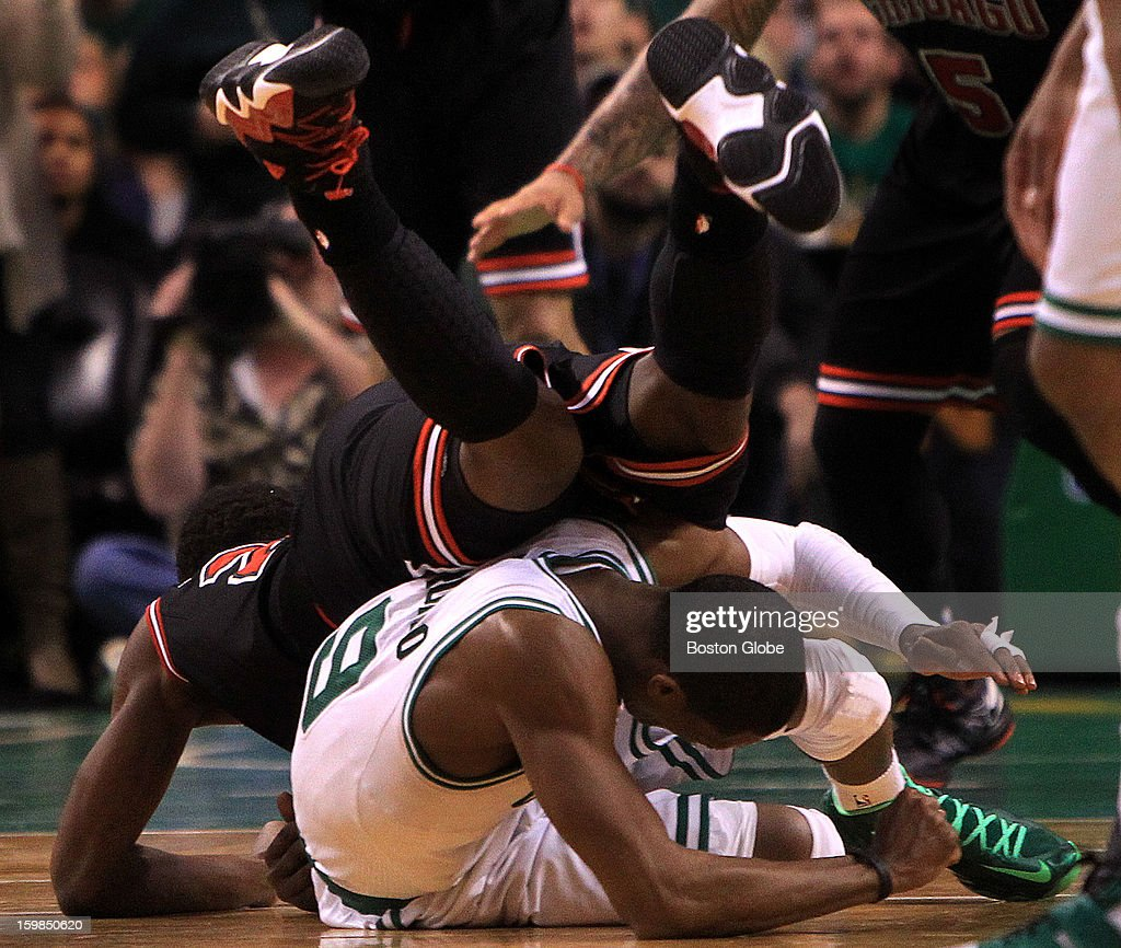 Boston Celtics point guard Rajon Rondo (#9) took a knee to the head from Chicago Bulls small forward Jimmy Butler (#21) during overtime as the Boston Celtics play the Chicago Bulls at TD Garden.