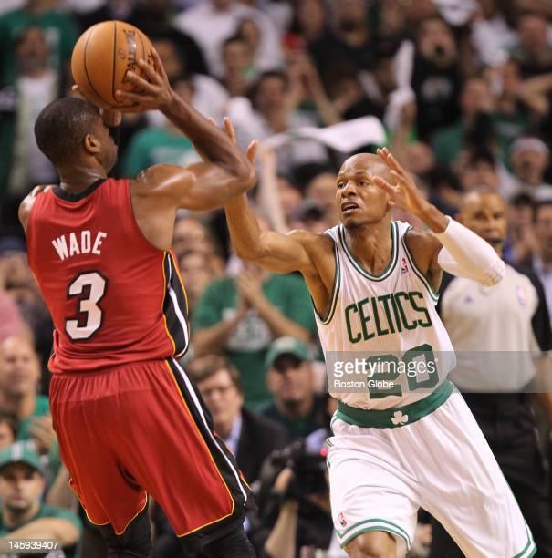 Boston Celtics point guard Rajon Rondo tries to block a shot by Miami Heat shooting guard Dwyane Wade in the first quarter Boston Celtics NBA...