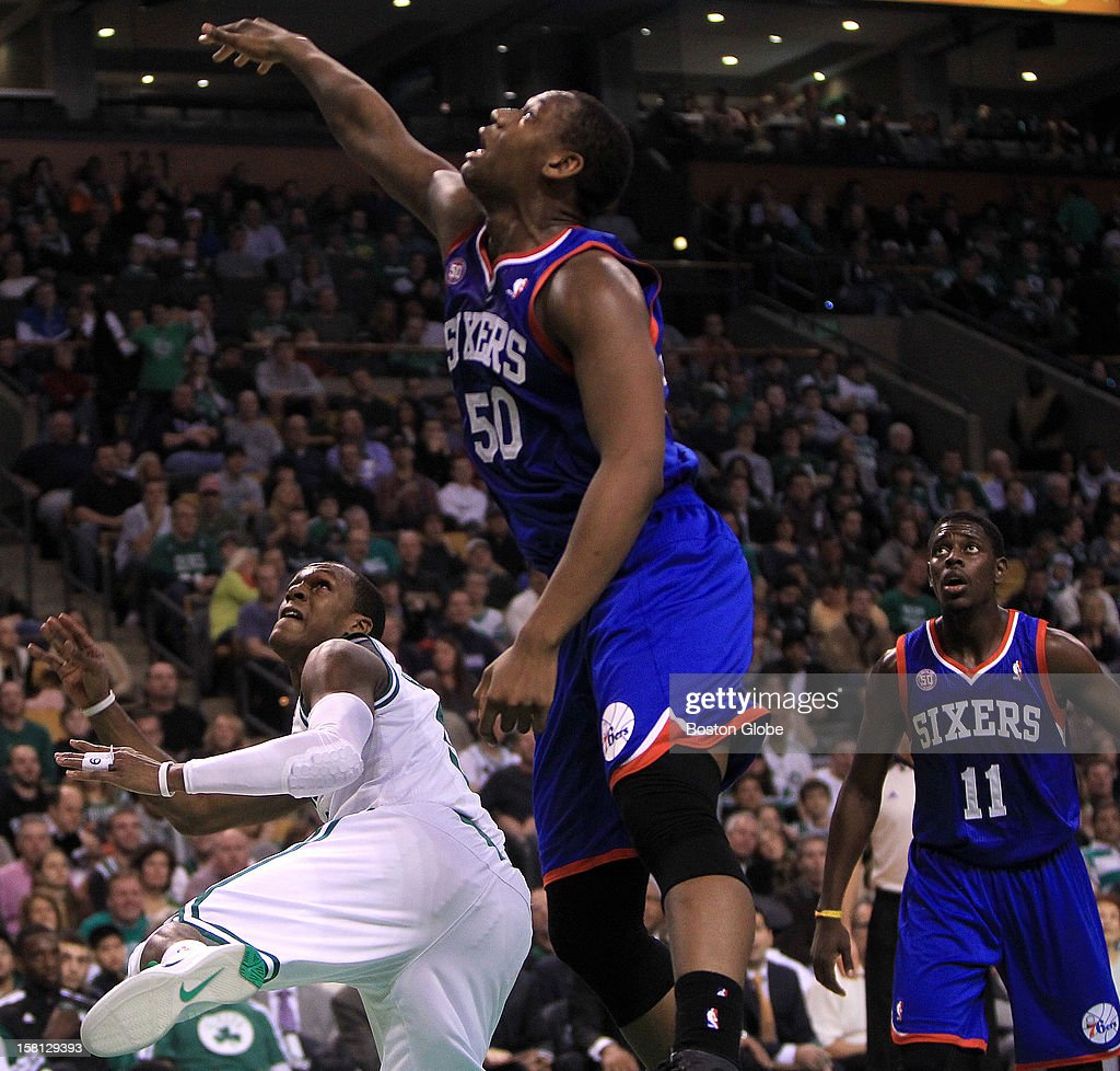 Boston Celtics point guard Rajon Rondo (#9) watches his off balance shot go in despite the defensive efforts of Philadelphia 76ers power forward Lavoy Allen (#50) to block the shot during the second quarter as the Celtics play the Philadelphia 76ers at TD Garden.
