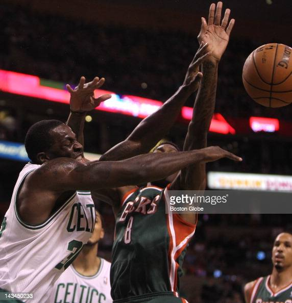 Boston Celtics power forward Brandon Bass is fouled by Milwaukee Bucks center Larry Sanders during the first half Boston Celtics NBA basketball...