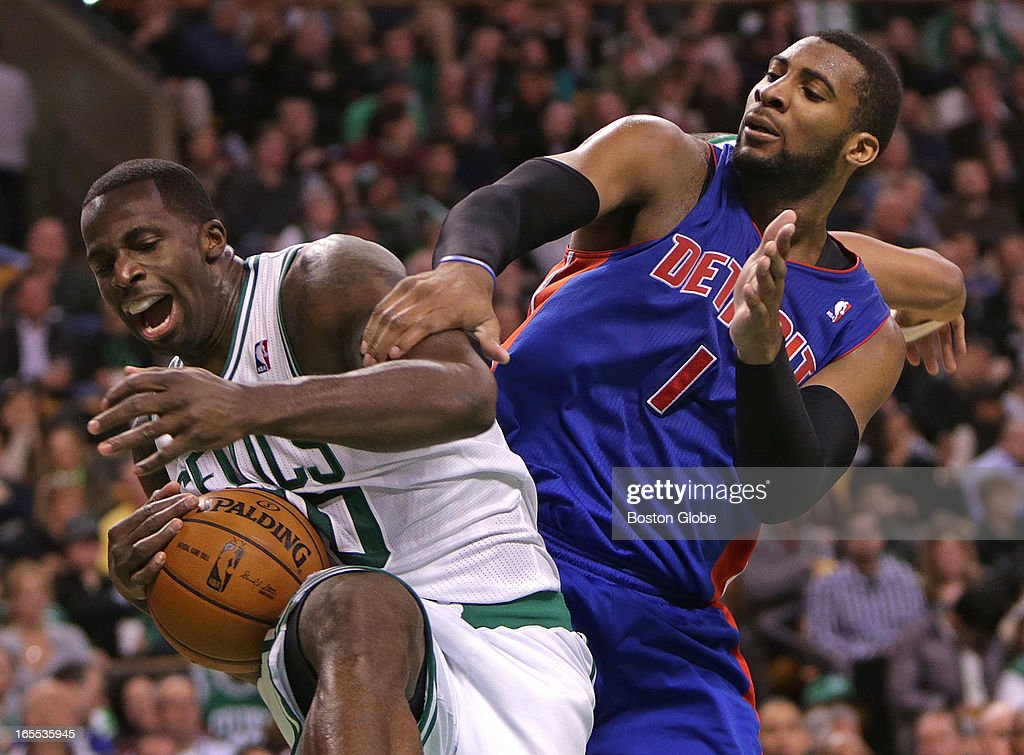 Boston Celtics power forward Brandon Bass (#30) pulls down a rebound away from Detroit Pistons center Andre Drummond (#1). Celtics NBA basketball, action and reaction. The Celtics play the Detroit Pistons at TD Garden.