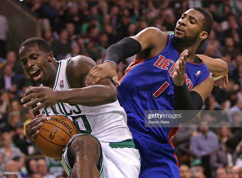 Boston Celtics power forward Brandon Bass (#30) pulls down a rebound away from Detroit Pistons center Andre Drummond (#1). Celtics NBA basketball, action and reaction. The Celtics play the Detroit Pistons at TD Garden.