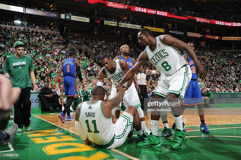 Boston Celtics power forward <a gi-track='captionPersonalityLinkClicked' href=/galleries/search?phrase=Glen+Davis+-+Basketball+Player&family=editorial&specificpeople=709385 ng-click='$event.stopPropagation()'>Glen Davis</a> #11 is being helped from the floor by his teammates during the game against the New York Knicks in Game One of the Eastern Conference Quarterfinals in the 2011 NBA Playoffs on April 17, 2011 at the TD Garden in Boston, Massachusetts. The Celtics won 87-85.