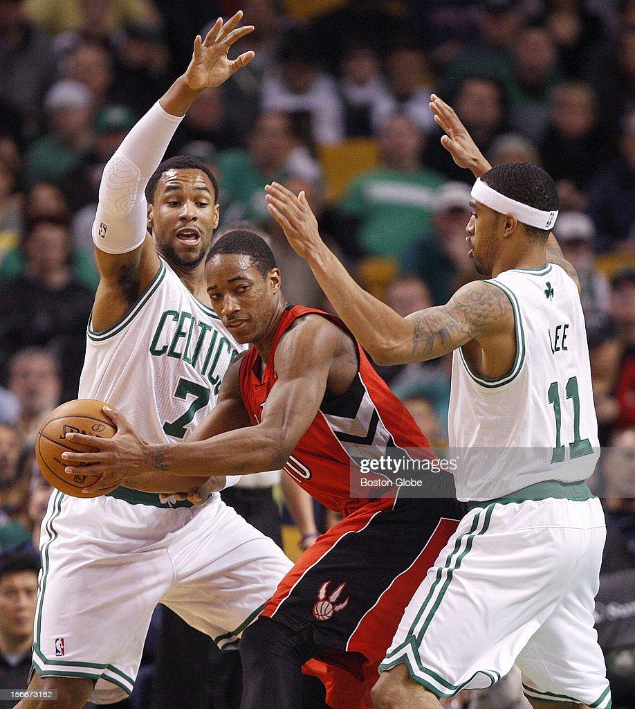 Boston Celtics power forward Jared Sullinger (#7) and Boston Celtics shooting guard Courtney Lee (#11) double down on Toronto Raptors shooting guard DeMar DeRozan (#10) during the first quarter as the Celtics play the Toronto Raptors at TD Garden.