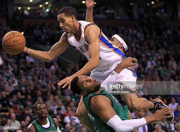Boston Celtics power forward Jared Sullinger draws an offense charge on Oklahoma City Thunder shooting guard Kevin Martin during the third quarter as...