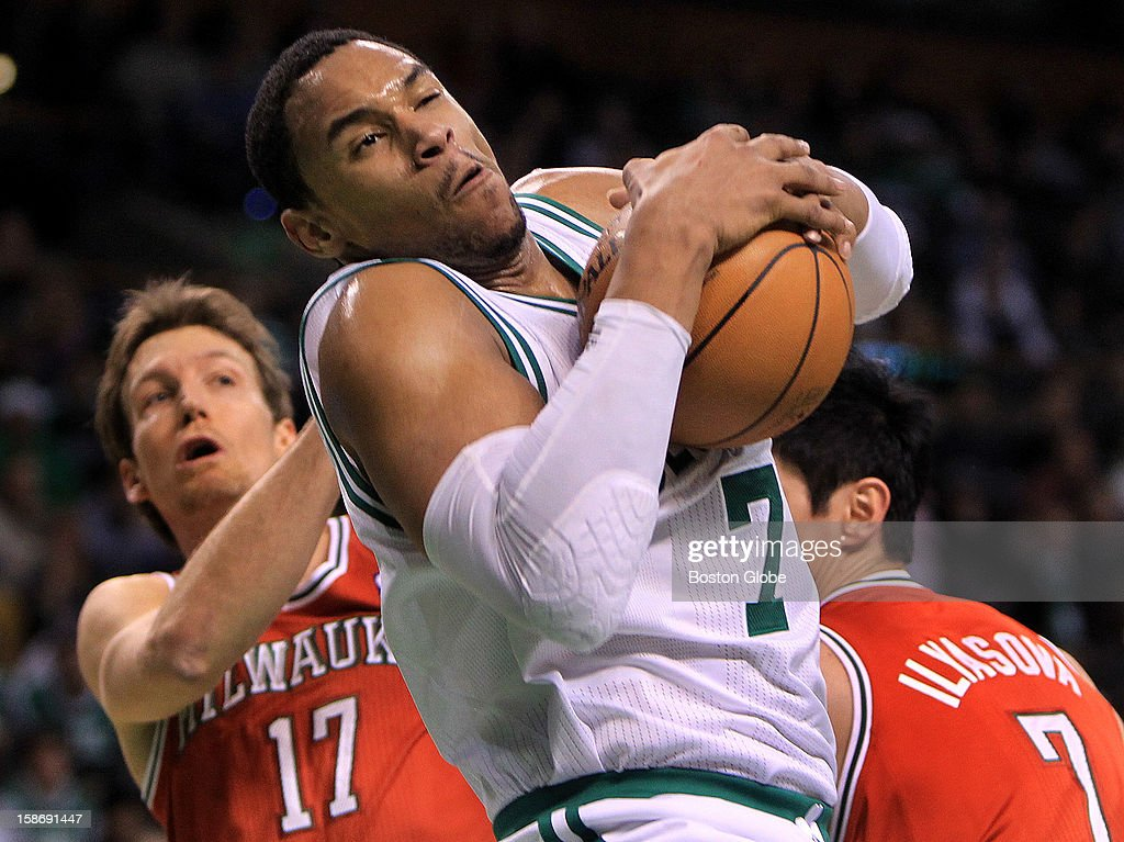 Boston Celtics power forward Jared Sullinger (#7) pulls down a offensive rebound and then puts it back up during the first half as the Celtics play the Milwaukee Bucks at TD Garden.