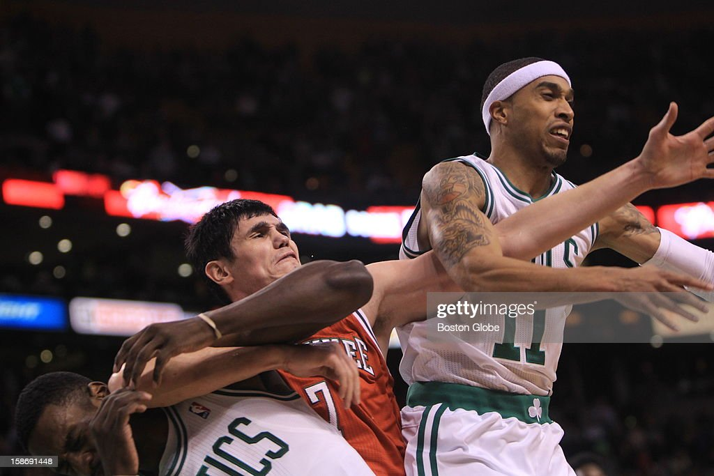 Boston Celtics power forward Jeff Green (#8) catches an elbow from Milwaukee Bucks small forward Ersan Ilyasova (#7) while battling for a defensive rebound in overtime as the Celtics play the Milwaukee Bucks at TD Garden. Green suffered a bruised left cheek and chipped teeth and left the game.