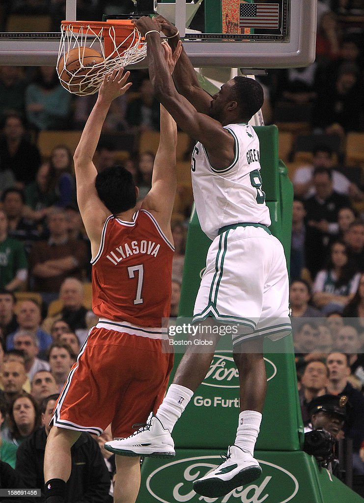 Boston Celtics power forward Jeff Green (#8) dunks an alley pop on an inbounds pass over Milwaukee Bucks small forward Ersan Ilyasova (#7) late in the fourth quarter as the Celtics play the Milwaukee Bucks at TD Garden.