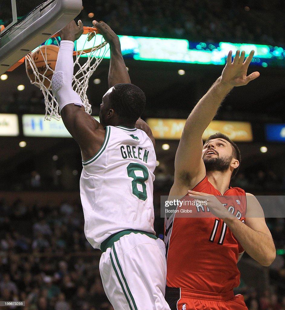 Boston Celtics power forward Jeff Green (#8) dunks over Toronto Raptors small forward Linas Kleiza (#11) during the first quarter as the Celtics play the Toronto Raptors at TD Garden.
