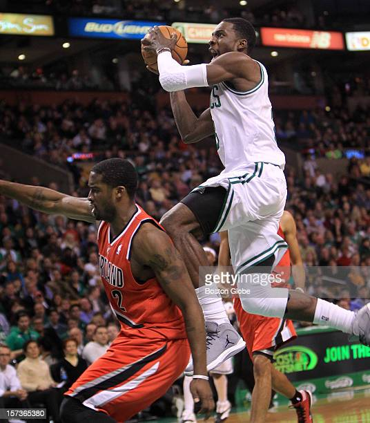 Boston Celtics power forward Jeff Green is fouled by Portland Trail Blazers shooting guard Wesley Matthews on this drive to the basket during the...