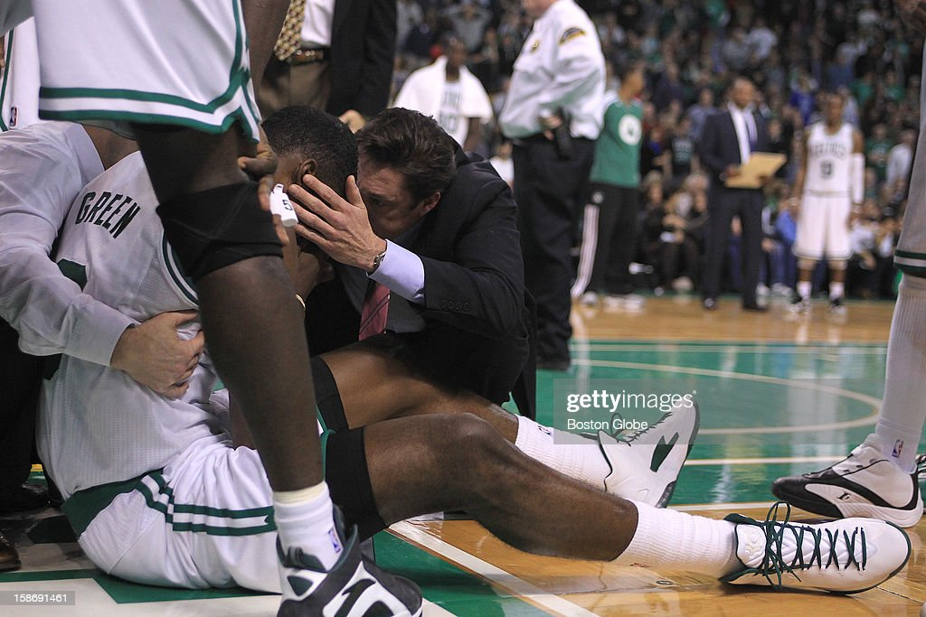 Boston Celtics power forward Jeff Green (#8) is tended to on the court after he went down from an elbow to his head late in overtime as the Celtics play the Milwaukee Bucks at TD Garden.