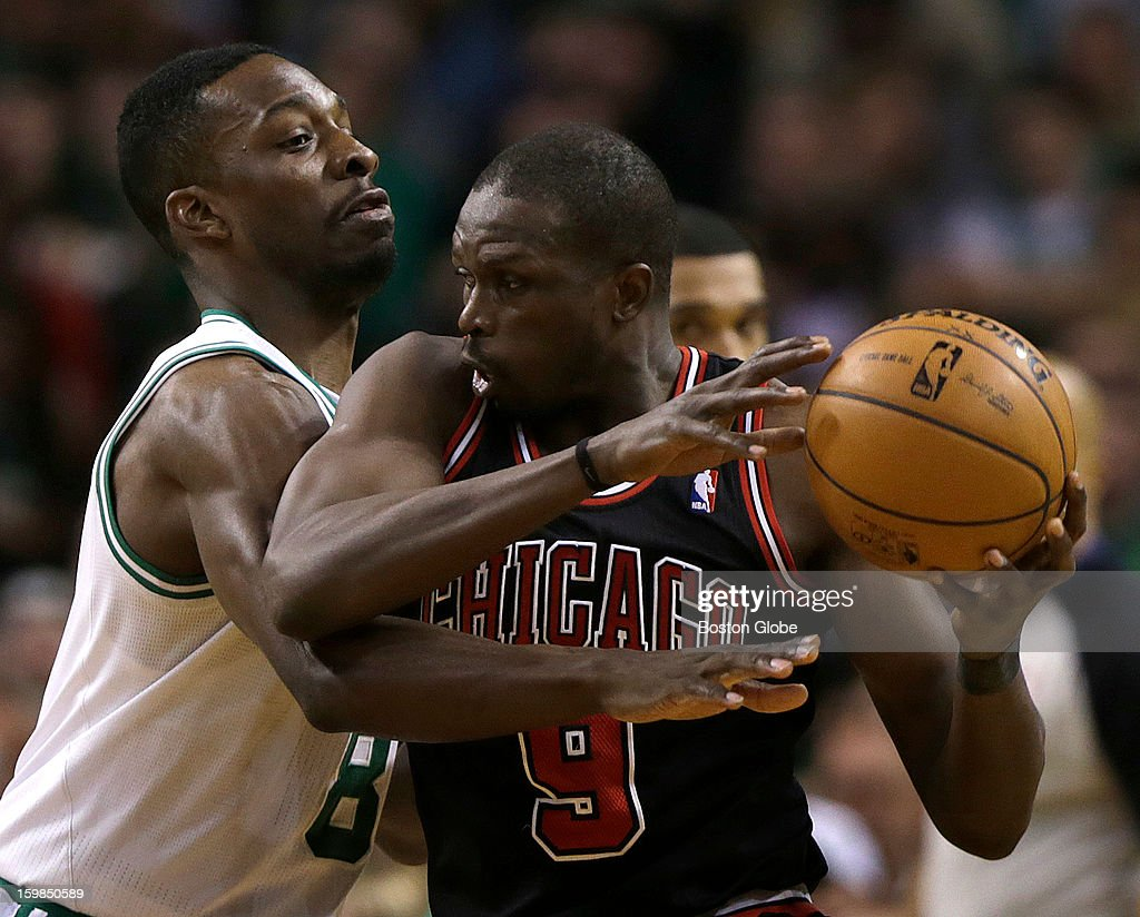 Boston Celtics power forward Jeff Green (#8) plays some tight defense on Chicago Bulls small forward Luol Deng (#9) during the first half as the Boston Celtics play the Chicago Bulls at TD Garden.