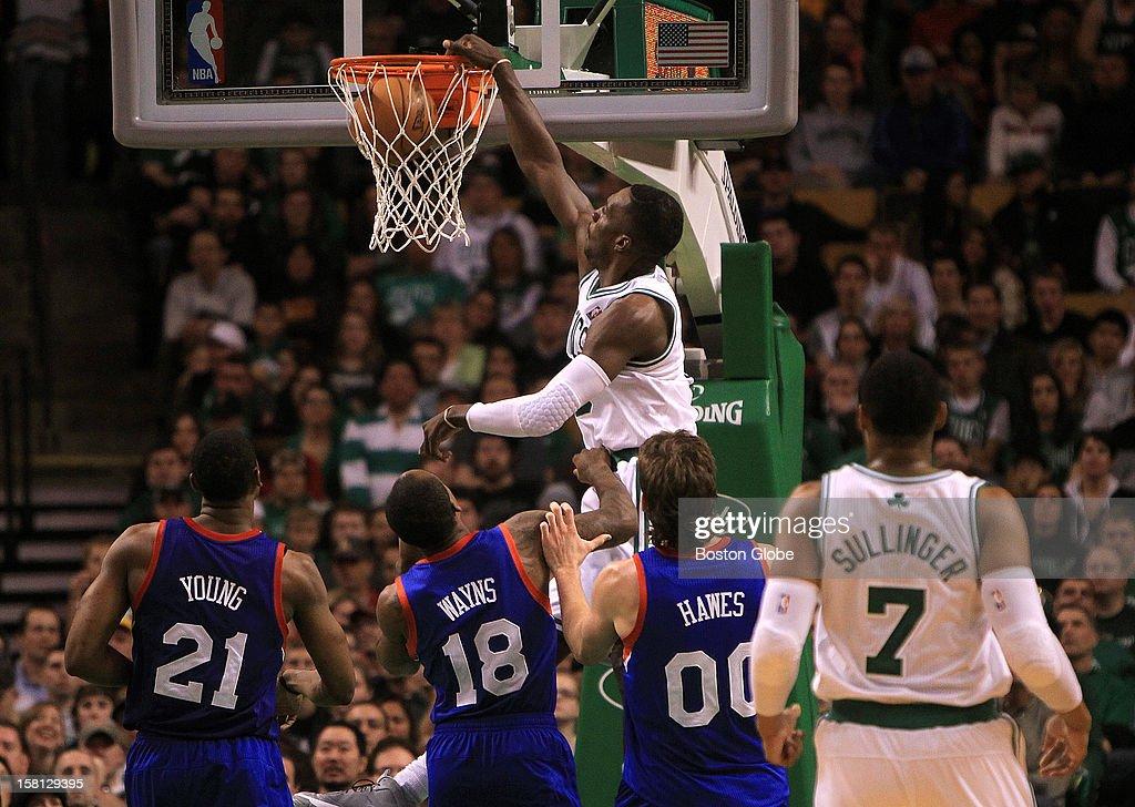 Boston Celtics power forward Jeff Green (#8) slams down a dunk to make it 81-63 in the fourth quarter as the Celtics play the Philadelphia 76ers at TD Garden.