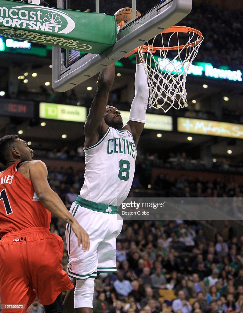 Boston Celtics power forward Jeff Green (#8) slams down an emphatic dunk over Portland Trail Blazers power forward Jared Jeffries (#1) during the second quarter as the Celtics play the Portland Trail Blazers at TD Garden.