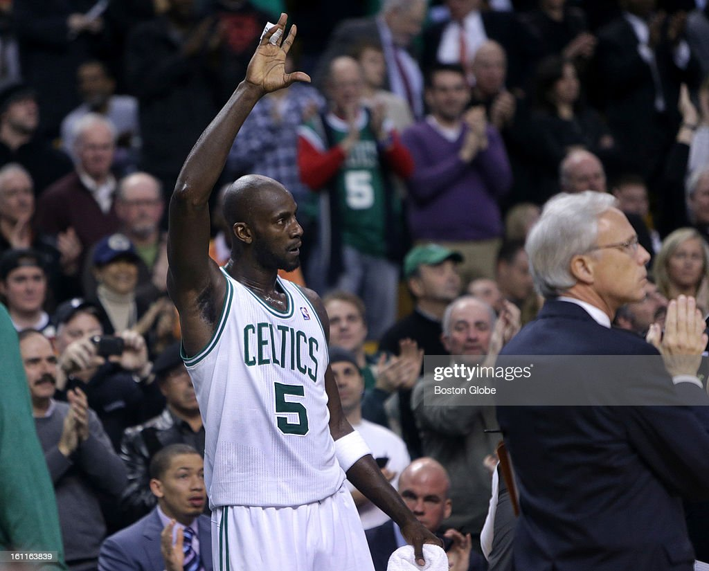 Boston Celtics power forward Kevin Garnett (#5) acknowledges the fans after it was announced he had scored his 25,000 career point during the second quarter as the Boston Celtics play the Los Angeles Lakers at TD Garden.