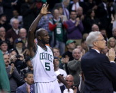 Boston Celtics power forward Kevin Garnett acknowledges the fans after it was announced he had scored his 25000 career point during the second...