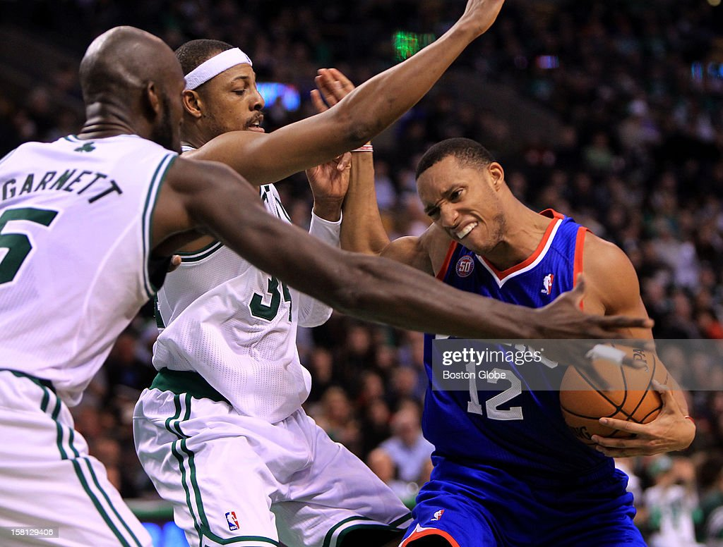 Boston Celtics power forward Kevin Garnett (#5) and Boston Celtics small forward Paul Pierce (#34) put the defensive squeeze on Philadelphia 76ers small forward Evan Turner (#12) during the third quarter as the Celtics play the Philadelphia 76ers at TD Garden.